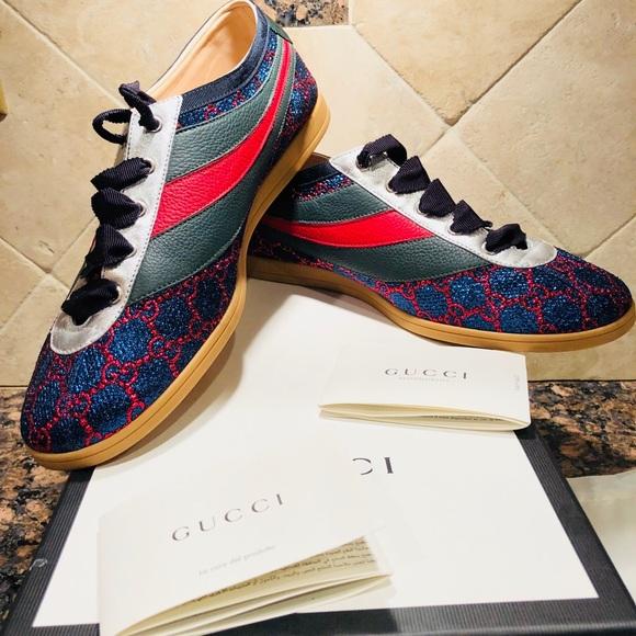 67d700be1e52b Men s Gucci Falacer Lurex GG Sneaker with Web. Gucci.  M 5ab4cd88a6e3ea1d915f8740. M 5ab4cd8c36b9de3eccfc46cd.  M 5ab4cd923afbbdf5982aaec8